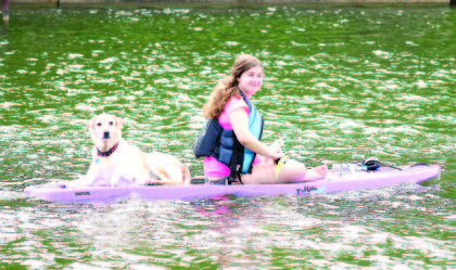 Sarah Zwick and her dog, Booty, take a break from paddling during the annual Paddle Williamstown event Aug. 25.