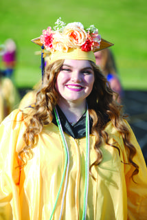 Savannah Toll shows off her decorated graduation cap.