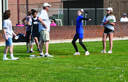 Grant County special Olympians compete in the softball throw competition.