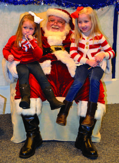 Sophia Testerman and Charlee Testerman got candy canes during their photo with Santa at CMZ.