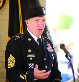 CSM David Munden of the Kentucky National Guard speaks to a crowd at the veterans cemetery May 28.