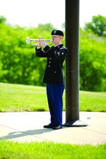 Taps specialist Eric Adams performs on the trumpet.
