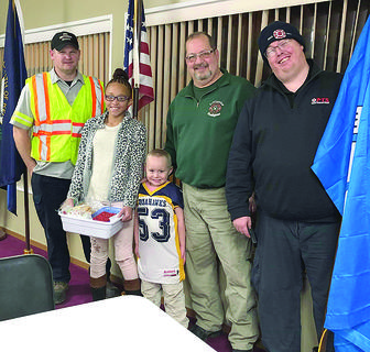TOMAHAWKS GIVE BACK — Grant County Tomahawks Youth Football baked and delivered holiday treats for first repsonders in Grant County as a way to give back to the community. Raniya Williams and Zach Justice dropped off a bucket of baked goodness to the Crittenden Fire Department.