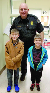 Campbell and Jameson Slayback took a photo with Williamstown Police Sgt. Steve Cornman after giving him baked goods. Photos submitted