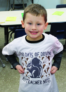 DRE student Zavier Maines shows off his 100 days T-shirt.